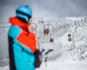 SkiLIft and Skier front Borobets Samokov Bulgaria